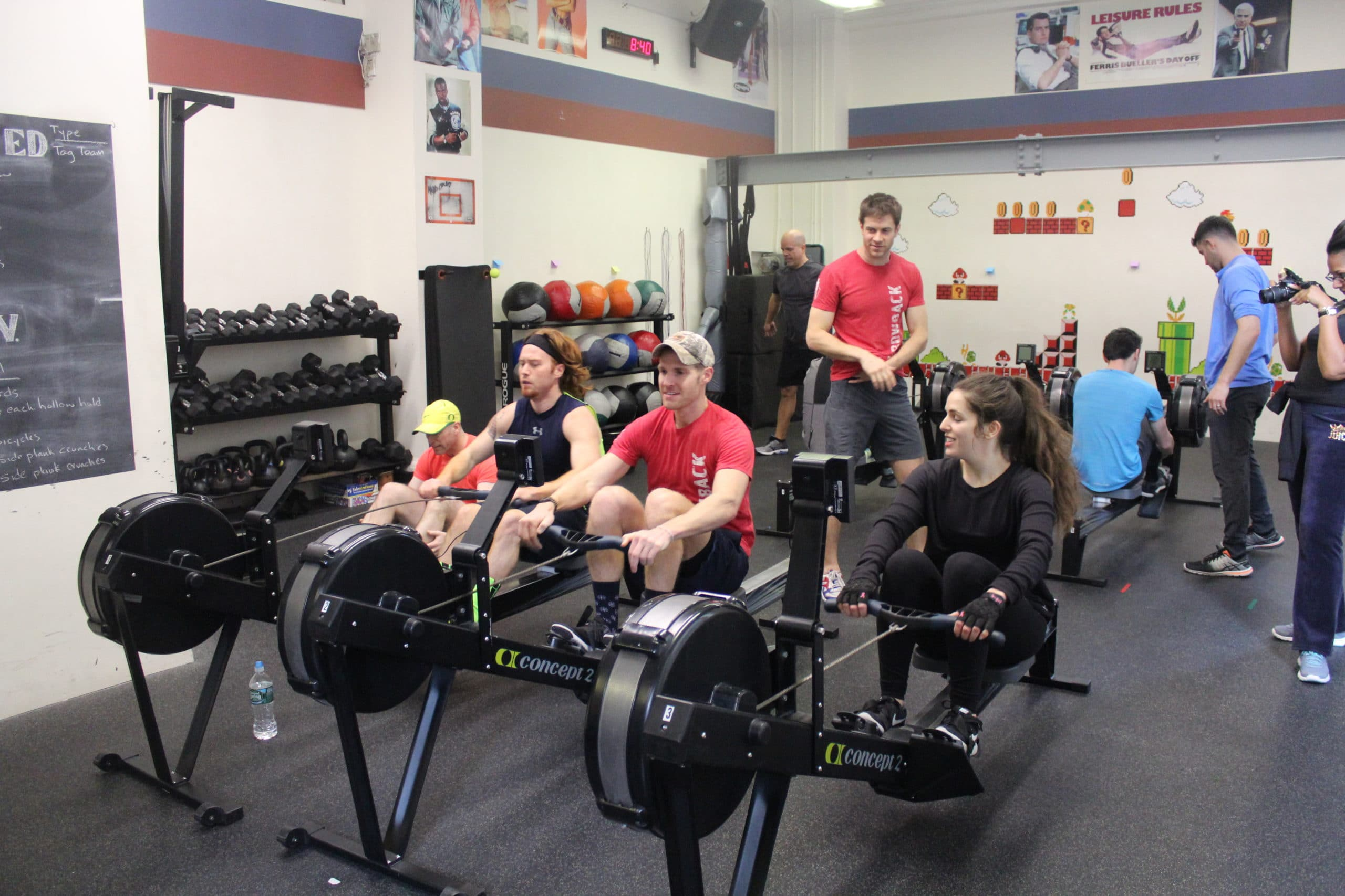 Matt and Nicole enjoying the rowing machine with Griffin Pinkow