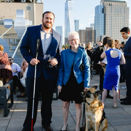 Three-time world champion athlete and introducer of one of our honorees for the evening, Kevin Brousard, with one of our attendees and her guide dog.